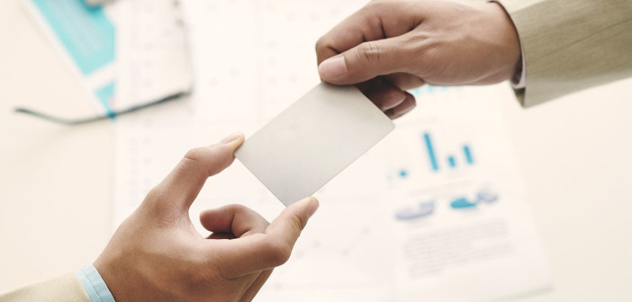 Hands of manager giving blank business card to his partner